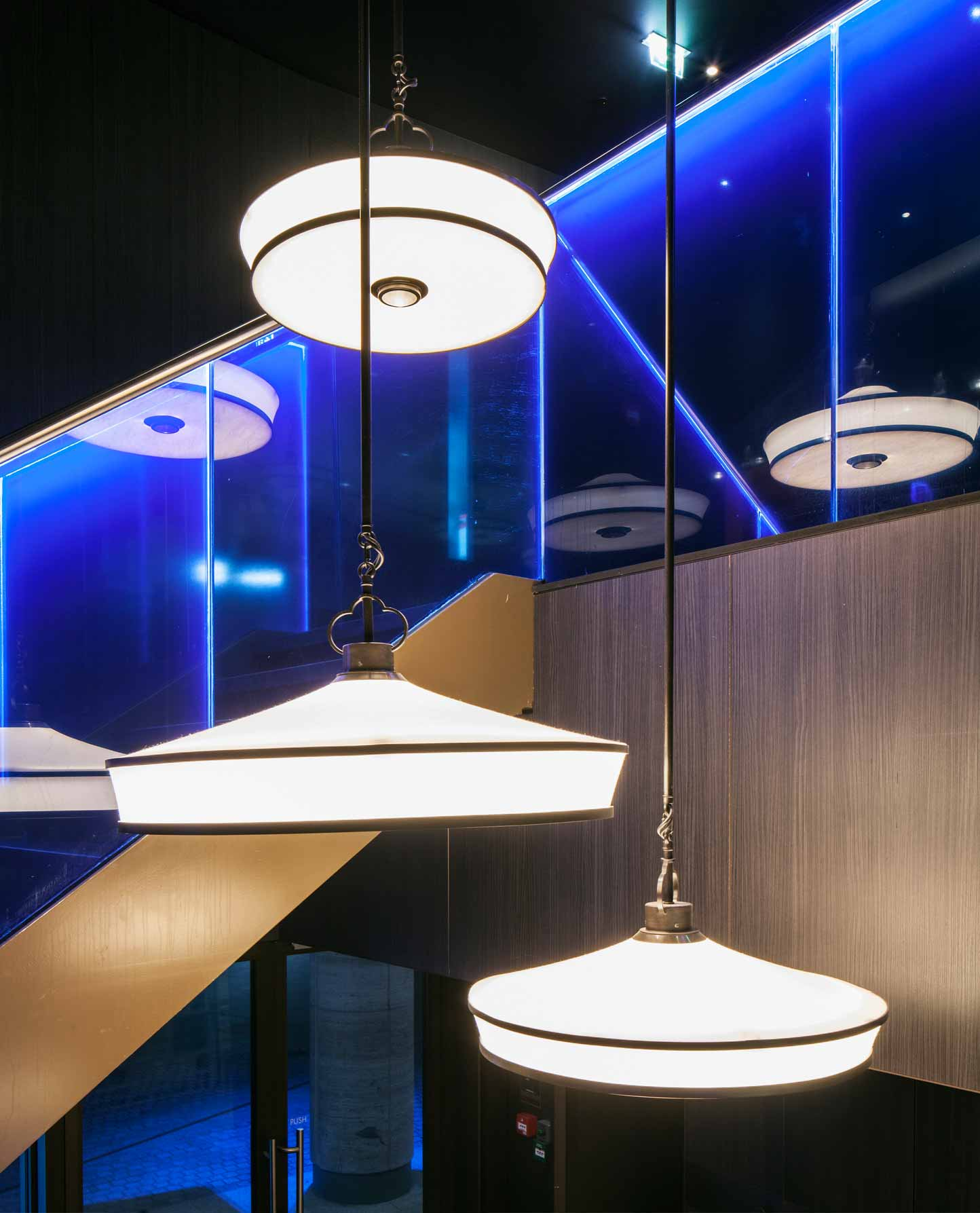 Circular Silk Pendants Illuminated Blue Staircase Nulty Bespoke