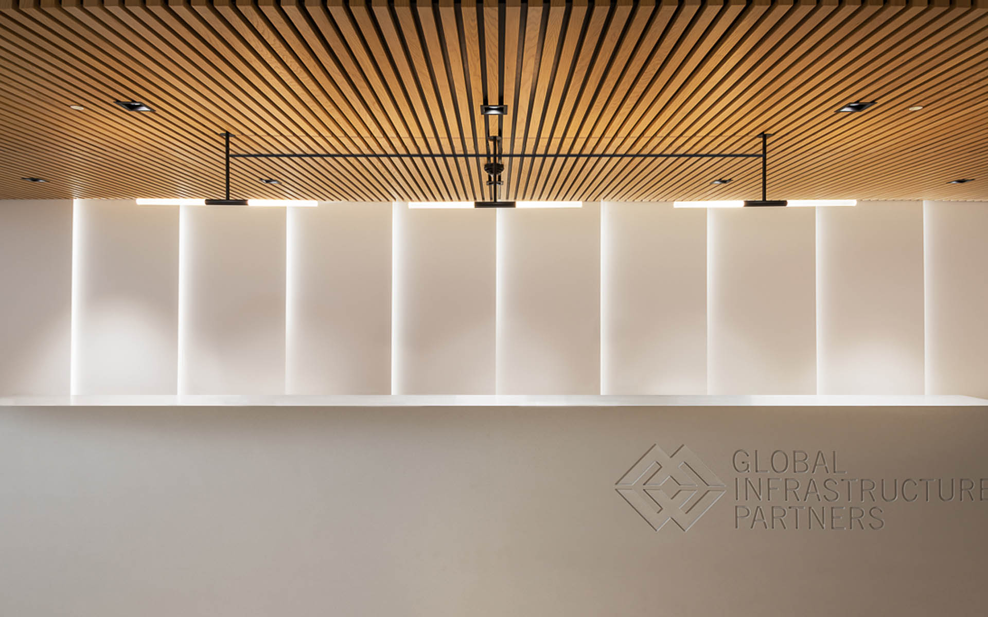 Custom Handcrafted Pendant Light Linear Batons Minimalist Sleek Design Office Reception Desk London Nulty Bespoke