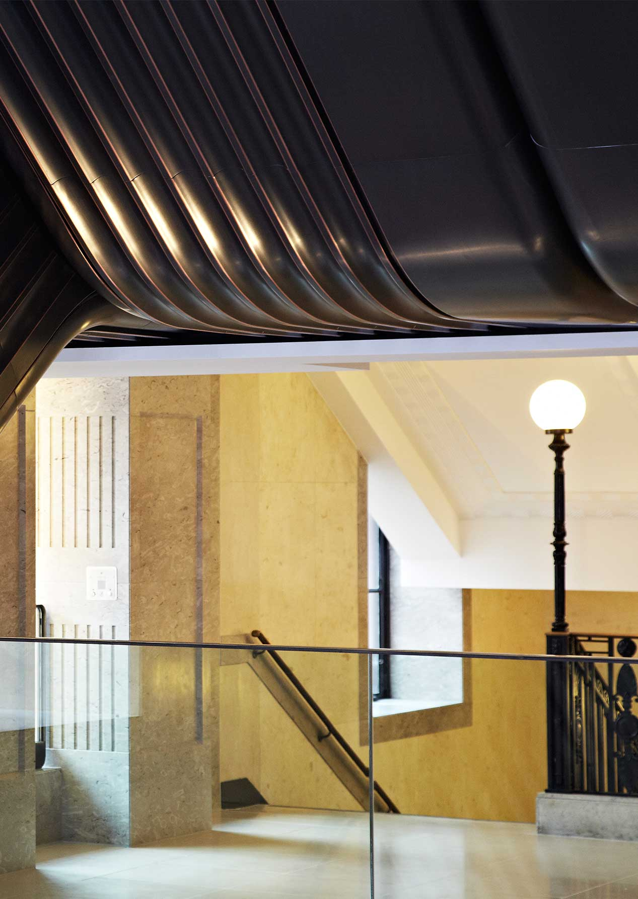 Cast Iron Newel Post Globe Light Fluted Bronze Cladded Escalator Nulty Bespoke