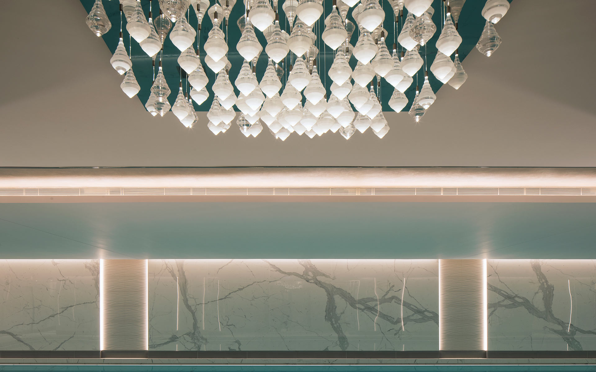 Striking Chandelier Suspended Droplets Cluster Reflective Ceiling Plate Luxury Spa Swimming Pool London Bespoke Lighting Designers Nulty Bespoke