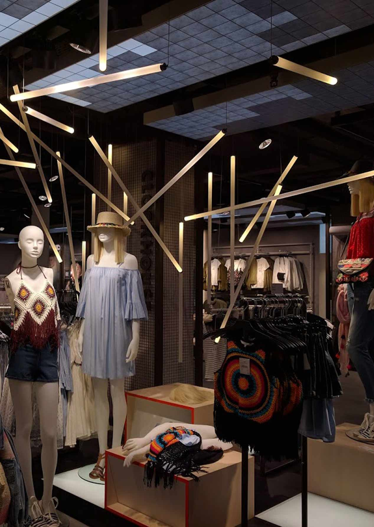 Randomly Suspended Illuminated Rods Installation Retail Display Nulty Bespoke